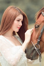 Preview iPhone wallpaper Asian girl and brown horse