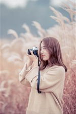 Preview iPhone wallpaper Asian girl use camera, reeds