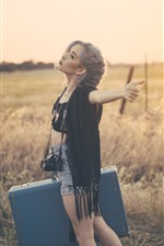 Preview iPhone wallpaper Blonde girl, suitcase, camera, grass, summer