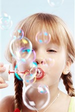 Preview iPhone wallpaper Cute child girl play bubbles