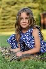 Cute little girl and kitten, meadow