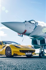 Preview iPhone wallpaper Ferrari F12 yellow supercar and fighter