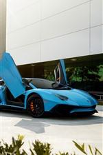 Lamborghini blue supercar, doors opened