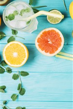 Lemonade, orange, kiwi, mint, wood board