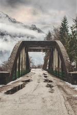 Preview iPhone wallpaper Mountains, bridge, road, fog, clouds, snow