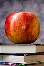iPhone обои Одно красное яблоко и книги, натюрморт