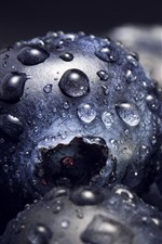 Preview iPhone wallpaper Some blueberries close-up, water droplets