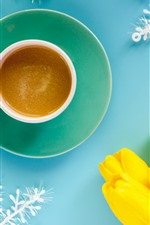 Yellow tulips, coffee, cup, snowflakes, blue background