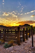 Preview iPhone wallpaper Fence, mountains, clouds, sunset