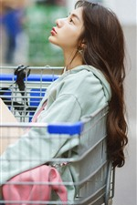 Preview iPhone wallpaper Girl sit on shopping cart