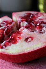 Preview iPhone wallpaper Half of pomegranate