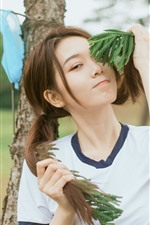 Preview iPhone wallpaper Lovely young Asian girl, playful, hairstyle