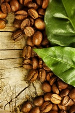 Preview iPhone wallpaper Many coffee beans, green leaves