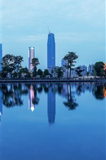 Preview iPhone wallpaper Nanning, city, skyscrapers, park, lake, dusk, China