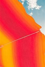 Orange umbrella, sky, clouds