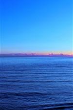 Sea, sunset, blue sky, glare