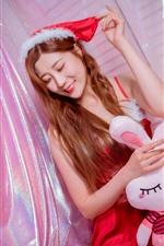 Sonrisa niña navideña, juguete conejo