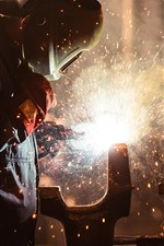 Preview iPhone wallpaper Sparks, welding, worker