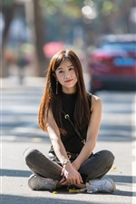 Preview iPhone wallpaper Asian girl sit at street