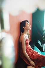 Preview iPhone wallpaper Asian girl, skirt, sofa, wall, hazy