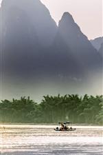 Preview iPhone wallpaper Beautiful Lijiang, mountains, river, sun rays, boat, China