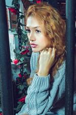 Blonde girl, curls, sweater