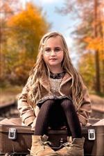 Cute blonde little girl, glasses, suitcase, railroad