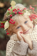 Cute child, little blonde girl, head decoration, berries