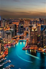 Dubai, cityscape at night, skyscrapers, lights, river, boats