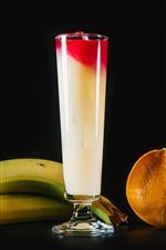 Fruit juice, banana, kiwi, orange, lemon, glass cups, black background