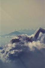 Girl sleeping, clouds, heels, mountains, creative picture