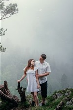 Lovers, trees, mountains, fog
