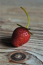 Preview iPhone wallpaper One strawberry, wood board