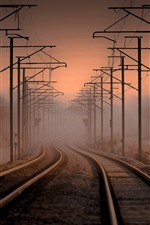 Preview iPhone wallpaper Railroad, power lines, fog