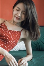 Preview iPhone wallpaper Red skirt Asian girl, smile, pose, bed