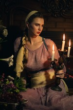Preview iPhone wallpaper Retro style girl, candles, flame, lily flowers, fireplace, dark