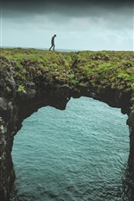 Preview iPhone wallpaper Sea, arch, nature bridge, man