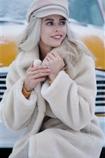 Preview iPhone wallpaper Smile blonde girl, taxi, snow, winter
