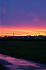 Sunset, orange sky, houses, river