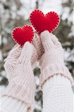 Two red love hearts, hands, gloves