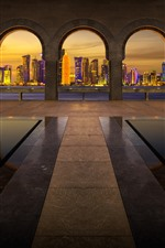 Preview iPhone wallpaper Walkway, arch, city, skyscrapers, lights, night