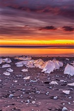 Preview iPhone wallpaper Winter, ice cubes, sea, sunset