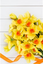 Preview iPhone wallpaper Yellow daffodils, bouquet, wood board