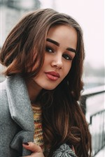 Preview iPhone wallpaper Brown hair girl, coat, city, hazy background
