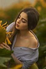 Girl and sunflower, morning