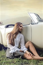 Girl sit at car side