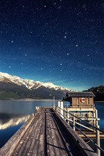 Preview iPhone wallpaper Lake, pier, hut, mountains, sky, stars