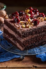 One piece of chocolate cake, cherry, nut
