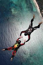 Skydivers, parachuting, sea, city, extreme sport