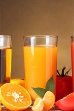 Three cups of fruit juice, apples, oranges, tomatoes